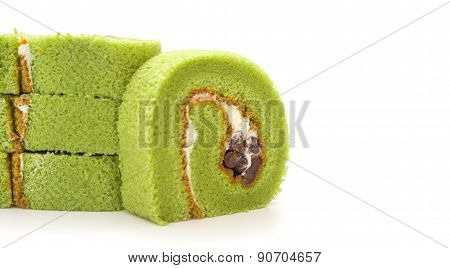 Four Pieces Of Yummy Cake Made By Green Tea And Mung Bean On A White Background With Copy Space