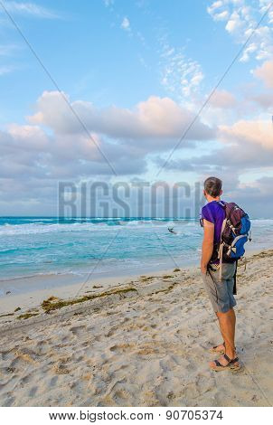 Young man admires view of Caribbean Sea