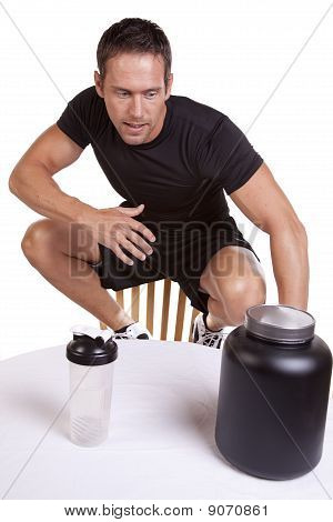 Man Looking At Protein Drink