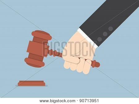 Businessman Hand Knocking Judge's Gavel