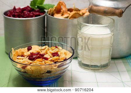 Blue Glass Bowl With Cornflakes In Front Of Old Cups