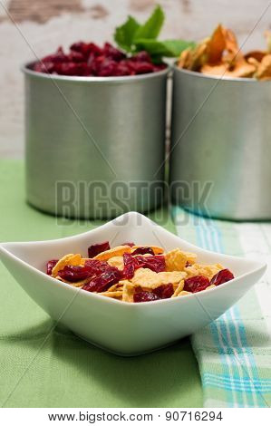 Bowl With Cornflakes In Front Of Two Aluminum Cups