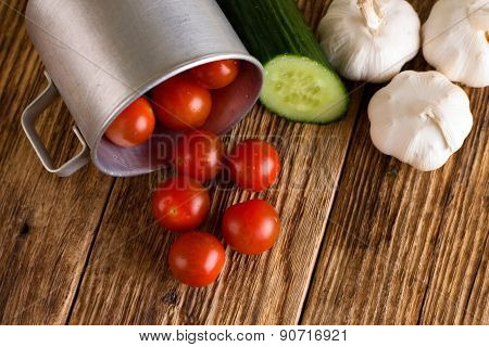 Cherry Tomatoes In Aluminum Cup And Various Vegetable