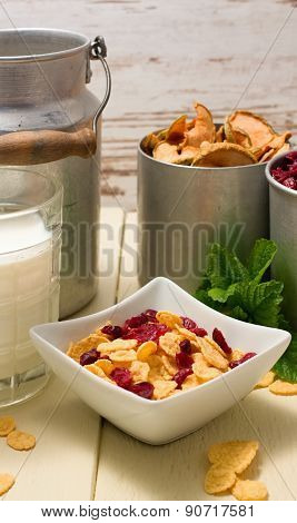 Square Bowl With Cornflakes And Old Can Plus Cups In Background