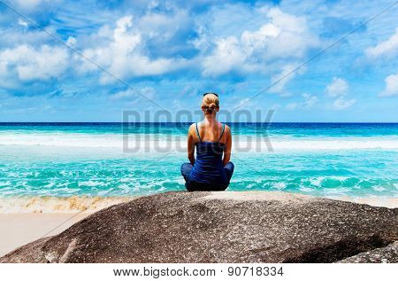 Young woman in lotus pose meditating