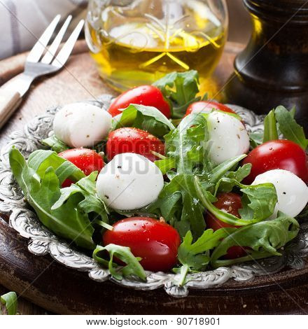 Fresh italian salad with mozzarella cheese