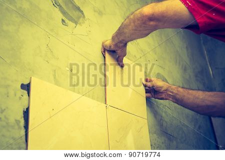 Vintage Photo Of Man Hands Work With Tiles And Mortar