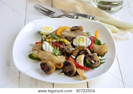 Chicken and mushroom salad with quail eggs, herbs