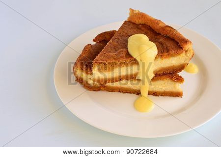 Cottage cheese and pumpkin pie with orange sauce