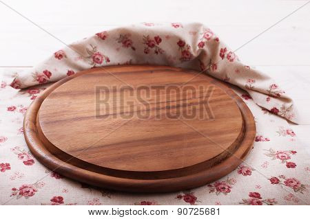 Empty wooden cutting board pizza on tablecloths for menu
