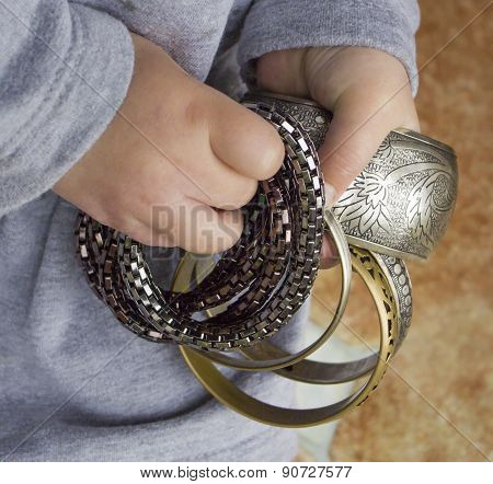 Bracelets In A Child's Hands