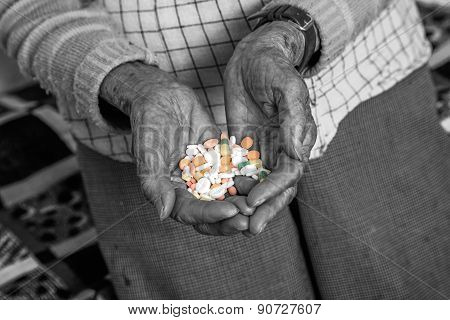 Old Woman Is Holding Medications In Her Hands