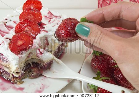Girl Dipping Strawberry Into Whipped Cream