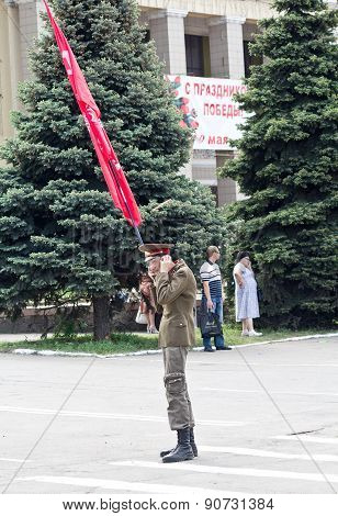 Makeevka, Ukraine - May, 9, 2012: A Supporter Of Communist Ideology With A Red Flag
