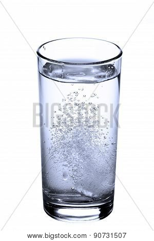 Tablet In Glass Of Water Isolated On White