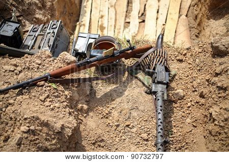 machine gun, rifle and ammunition in the trenches