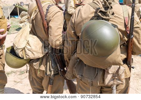 two Soviet soldiers with knapsack and helmets behind