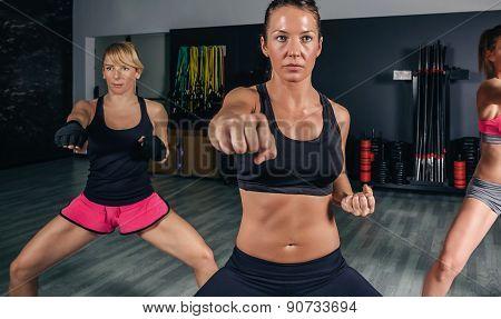 Women in a boxing class training punch