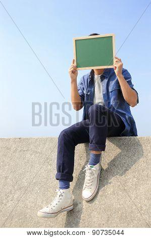 Happy Man Holding Blackboard