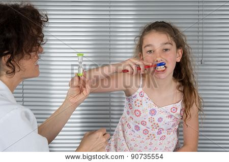 Smiling Young Girl Of Ten Years Old Brushing Teeth