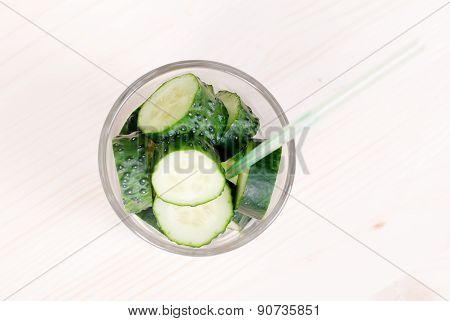 Sliced Cucumber Slices In A Glass Tube, Top View