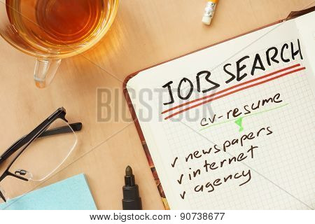 Notepad with words job search concept.