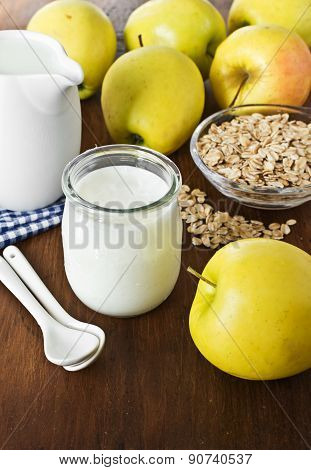 Homemade Yogurt With Apples And Oatmeal On Wooden Table.