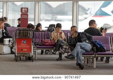 HONG KONG - MARCH 09, 2015: Hong Kong International Airport interior. It is the main airport in Hong Kong. It is located on the island of Chek Lap Kok