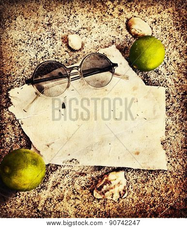 Beach background with copyspace, beach sand summer theme, sea shels, sunglasses over sand texture an