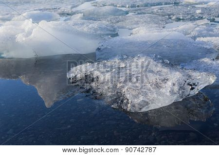 Ice melting on Jokulsarlon lagoon glacier, Iceland