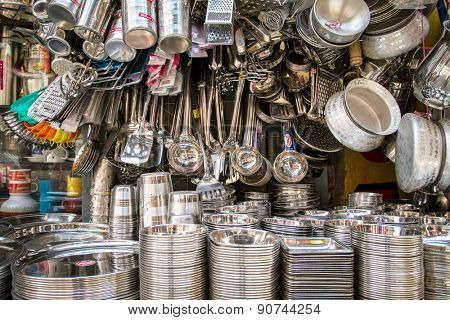Delhi, India - March 30, 2013: Stainless steel utensil on the market in India on the market in Delhi, India
