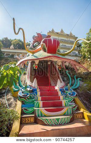 Kanchanaburi, Thailand - January 6, 2015: Dragon head as the entrance to Wat Ban Tham, temple in Kanchanaburi province, Thailand