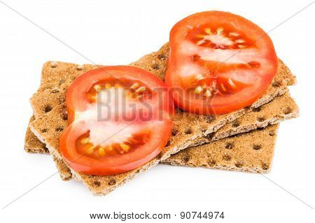 Wheat Crisp Bread With Slice Of Tomatoes Isolated On White