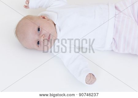 portrait of lying a one month old baby girl