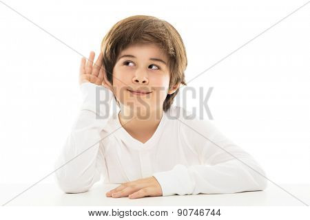 Boy with a hand to ear in a listening gesture