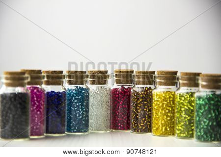 Tiny glass bottles filled with beads