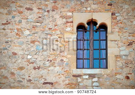 Stone wall with a decorated window, Middle Ages