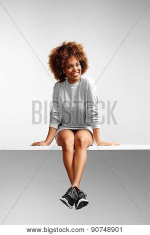 Sitting Girl Wearing Sweatshirt Dress