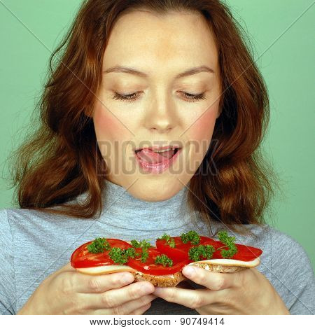 Hungry Woman Holds Sandwich