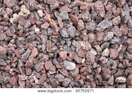 Closeup of crushed gravel stone background or texture. Top view. Photo texture
