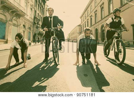 Businesspeople riding on bikes and running in city - retro style photograph