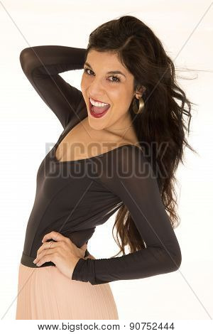 Beautiful happy dark brunette female model posing in a tight black top smiling