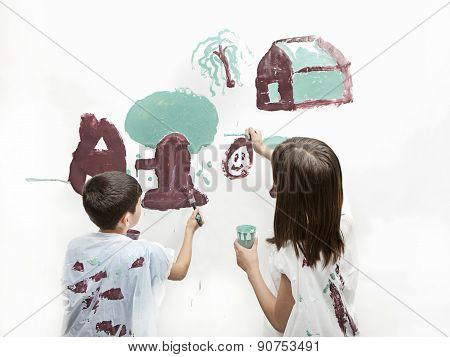 Siblings Painting A Picture.