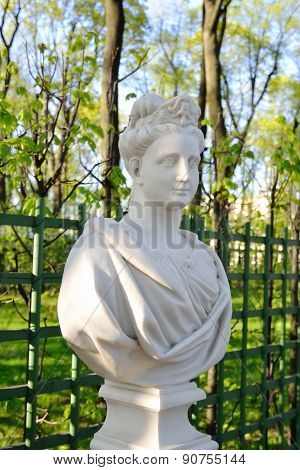 The Statue Of A Young Woman.