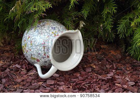 Antique Jug Under A Fir-tree