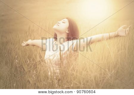 Joyful Woman Enjoying Fresh Air On Meadow