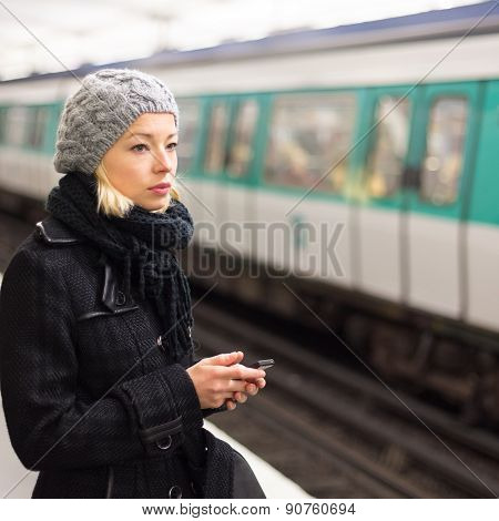 Woman on a subway station.