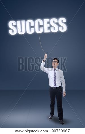 Male Worker Pulling A Success Text