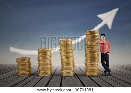 Marketing Agent And Rising Gold Coins Chart