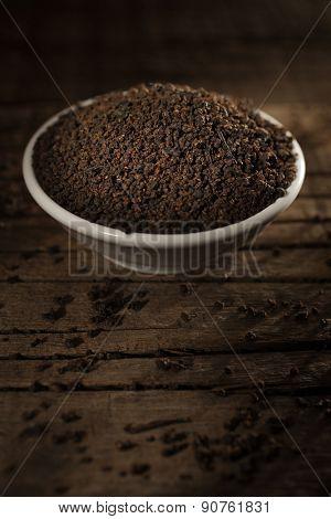 Black tea against wooden background